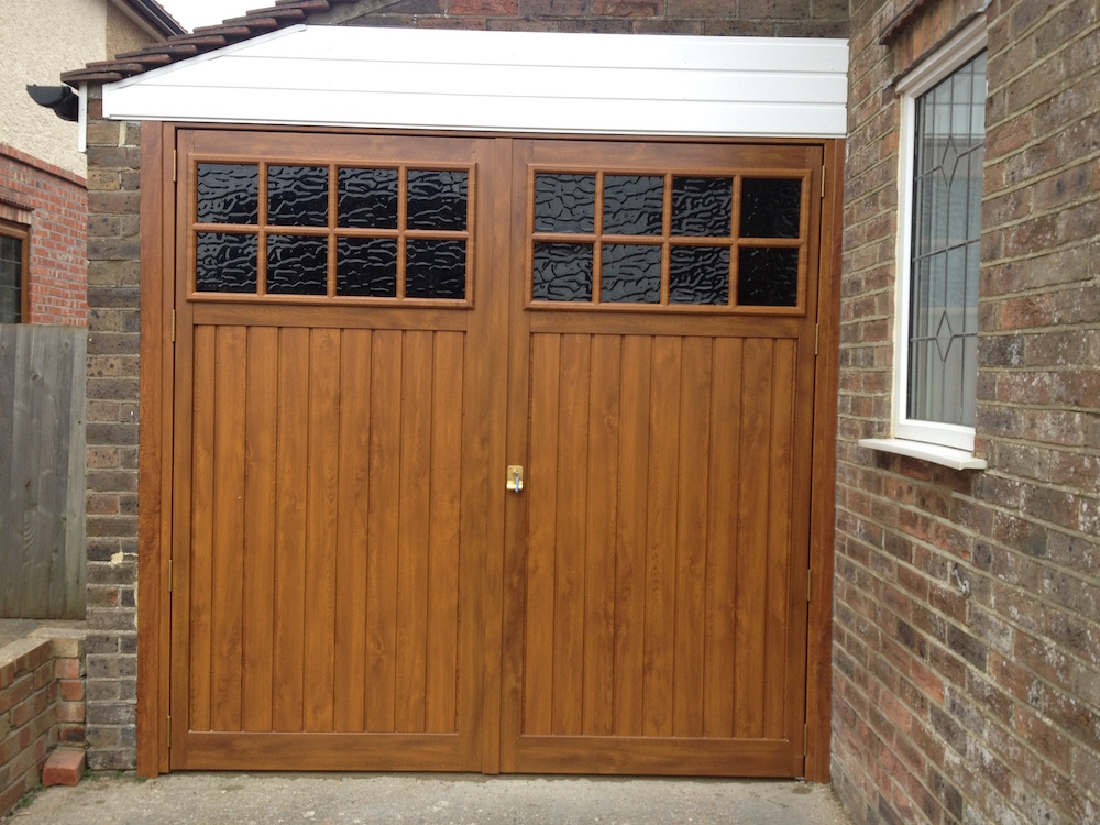 why side with side hinged garage doors south east