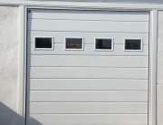 Sectional garage door with windows