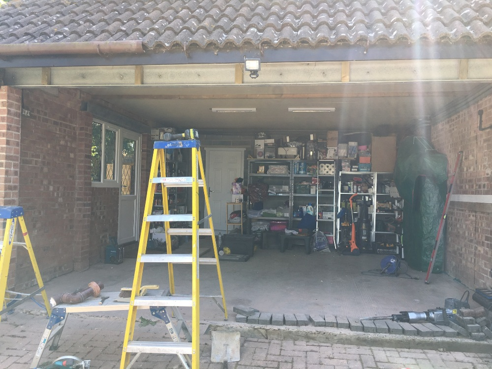 Twin garages converted into one double
