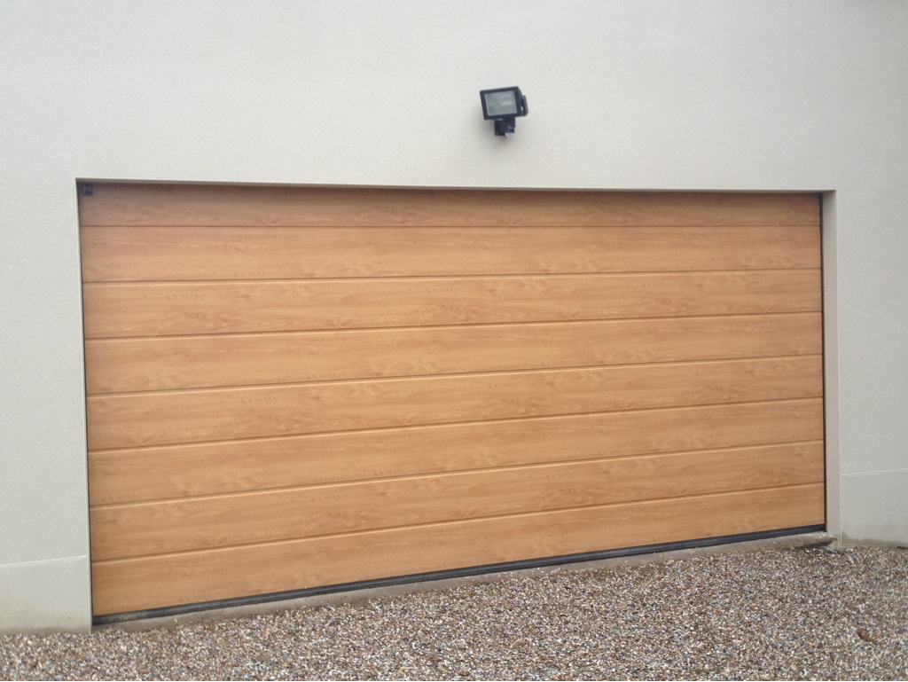 South east garage doors repairs replacement services to east hormann m ribbed light oak sectional door rubansaba