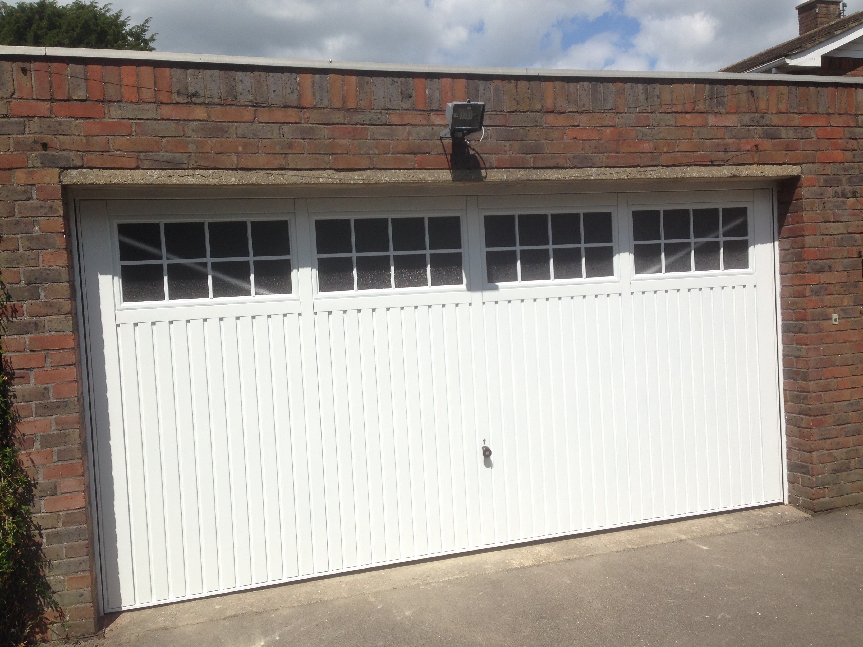 used spring with when install slider lifetime to today come store safe here it being is also drive brighton the tracey c garage screens over screen a track vehicles door your repair warranty
