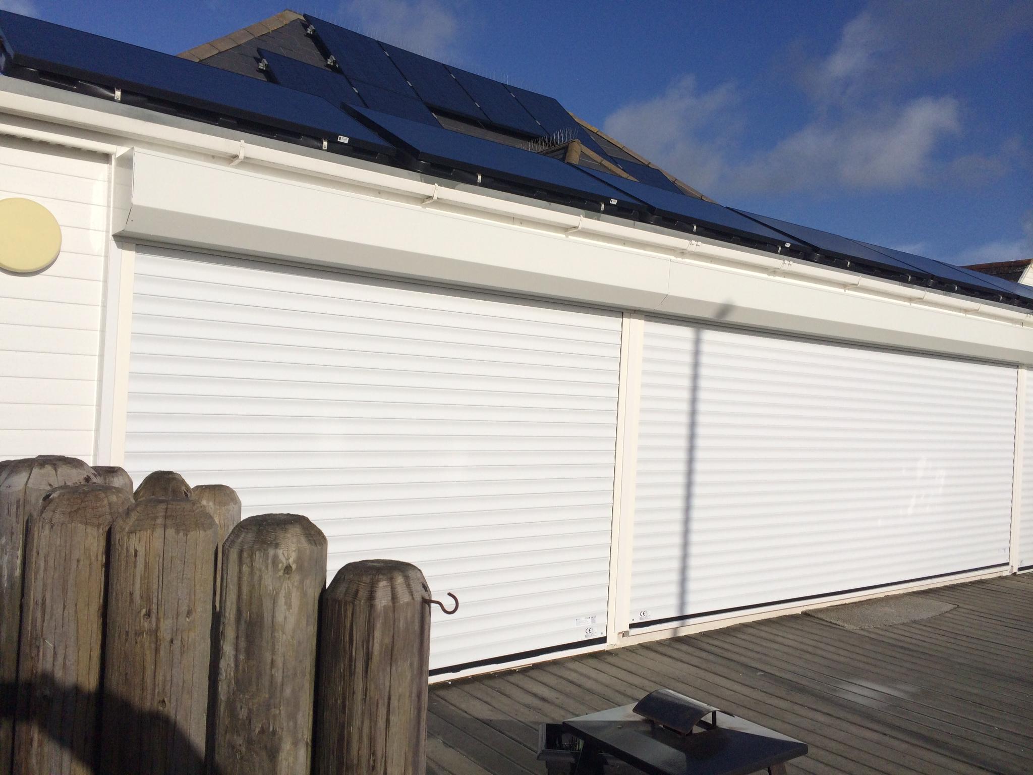 Roller garage doors for shutters