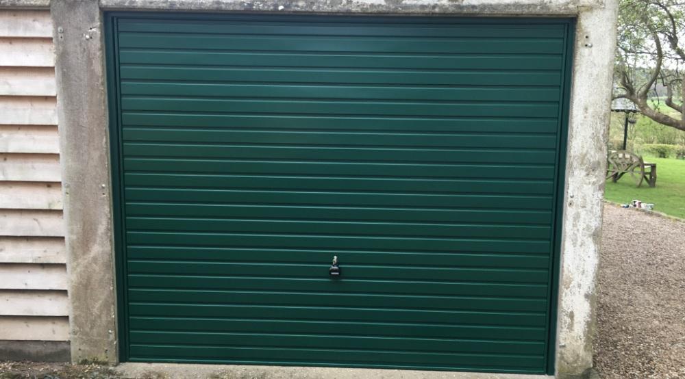 Garage door for concrete garage