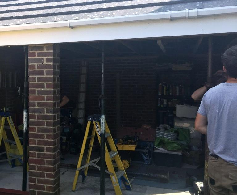 Support needed before removing pillar between two garage doors