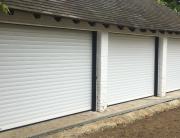 Triple roller garage doors