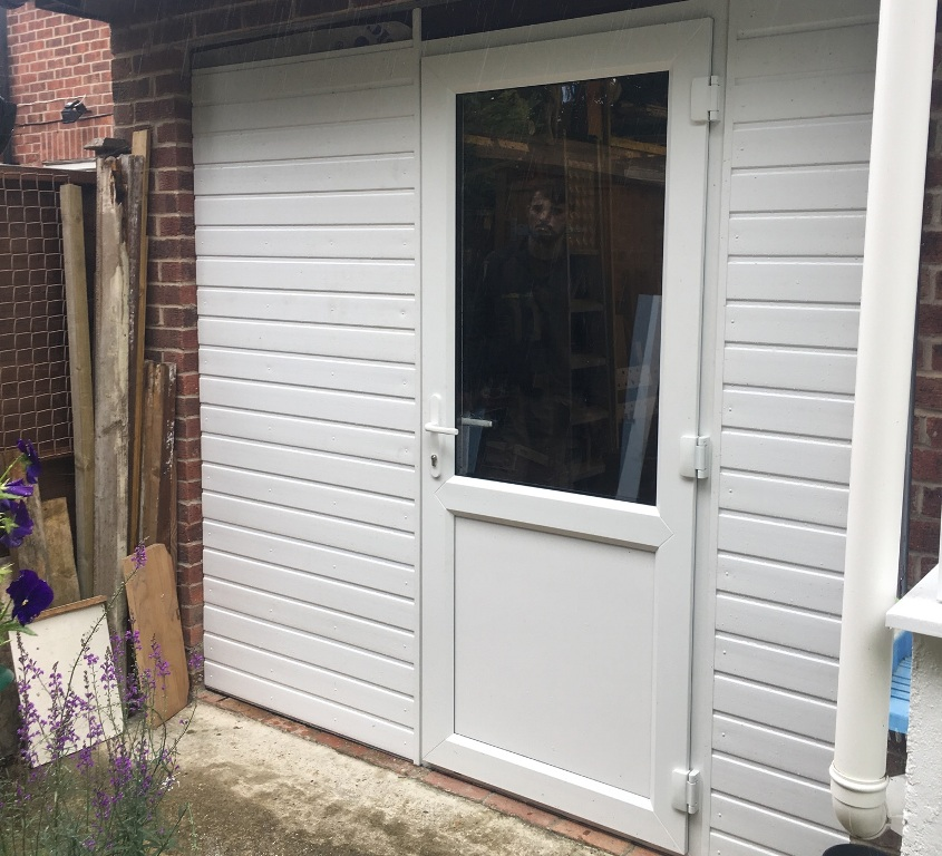 Replacement back door and garage cladding