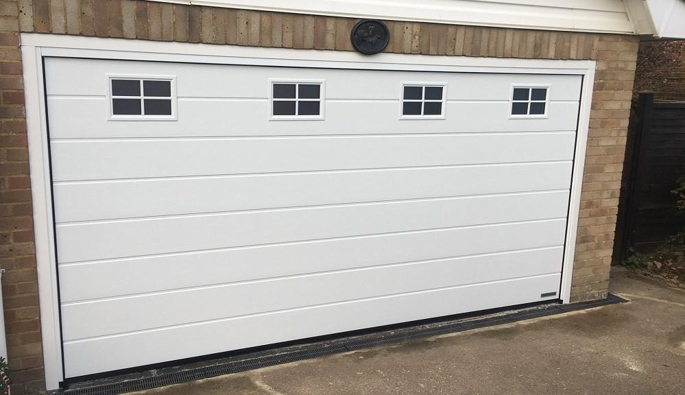 Sectional garage door with cross windows