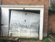 When is it time to repair or replace your garage door?