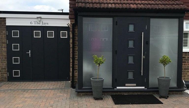 Fitness studio garage door entrance complements existing front door